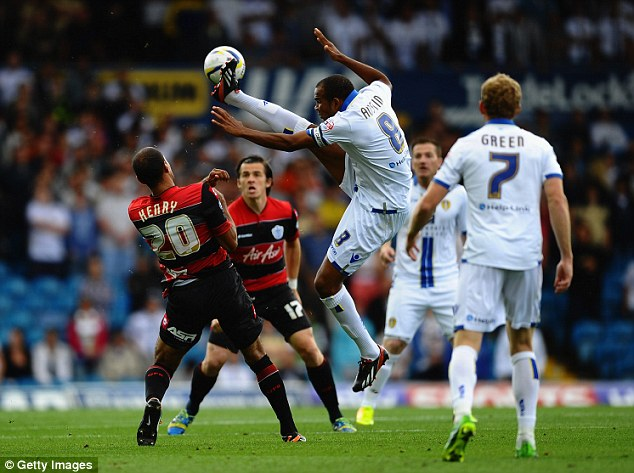 Getting stuck in: Rodolph Austin of Leeds United battles with QPR's Karl Henry