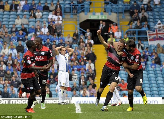 Vital strike: Clint Hill celebrates his winner with QPR team-mates