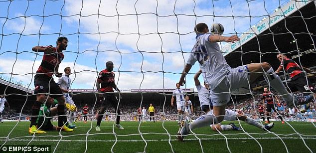 The decider: Hill (right) seals the win for QPR