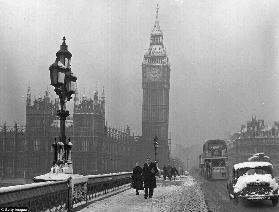 Cold winter conditions forced people to burn more coal to get keep warm, leading to increased levels of air pollution throughout the 1900s. Workers are seen traversing a snow cased Westminster Bridge in London