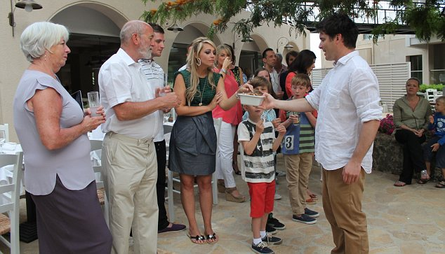 Tom Herbert hands out pieces of his new pizza to guests at the Marbella Beach Hotel