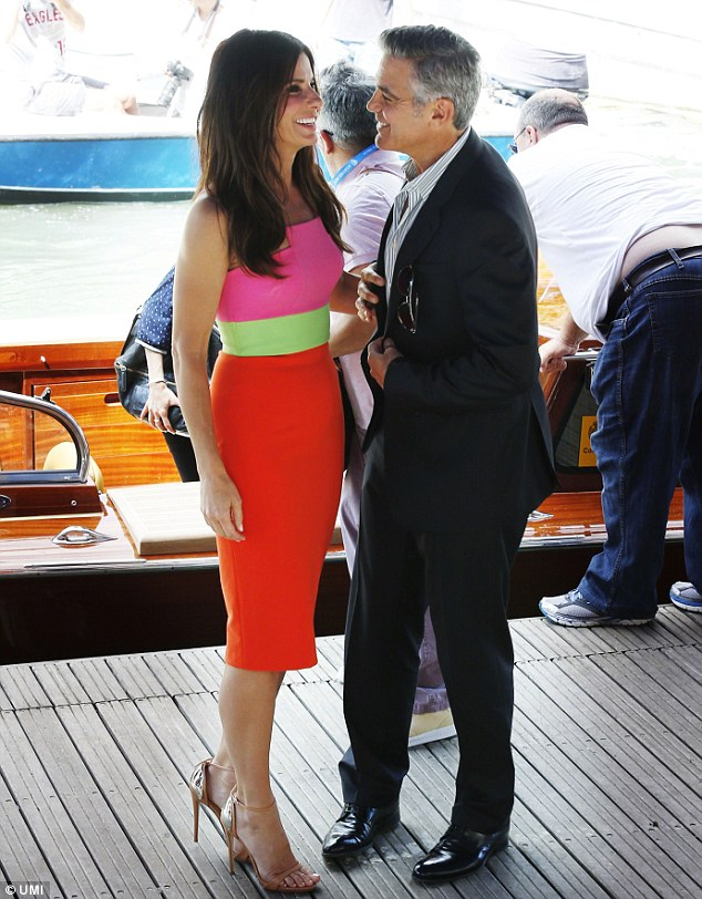 Can't take my eyes off of you! The co-stars and long time friends are snapped sharing another intimate moment as they attend a photocall for their film Gravity at the Venice Film Festival
