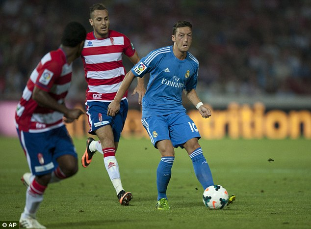 Heading to England? Mesut Ozil was left on the bench for Real Madrid with Arsenal a possible move
