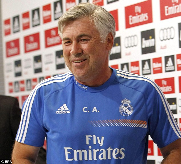 All smiles: Bale will be managed by former Chelsea boss Carlo Ancelotti, who took over at Madrid this summer