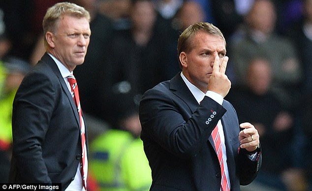 In the dugout: Liverpool manager Rodgers (right) and Manchester United boss David Moyes