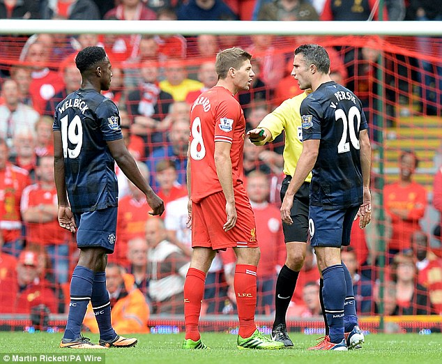 Fiesty: Steven Gerrard and Robin van Persie share their thoughts with each other