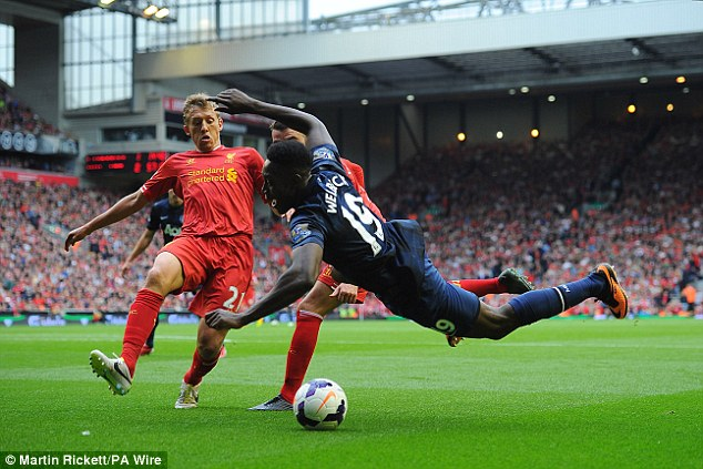 Fall: Danny Welbeck takes a tumble after pressure from Lucas and Iago Aspas