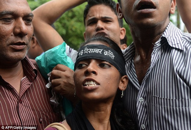Outrage: Activists shouted slogans as they demanded the death of a juvenile and called for the reform of laws for crimes against women