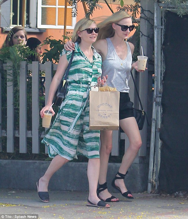Besties: The actress' friend placed an affectionate hand on her shoulder