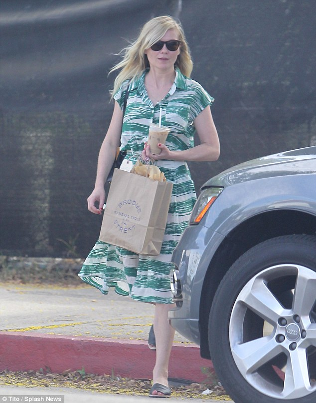 Staying cool: Kirsten Dunst grabbed a refreshing iced coffee for a summer outing in Los Feliz, California, on Saturday