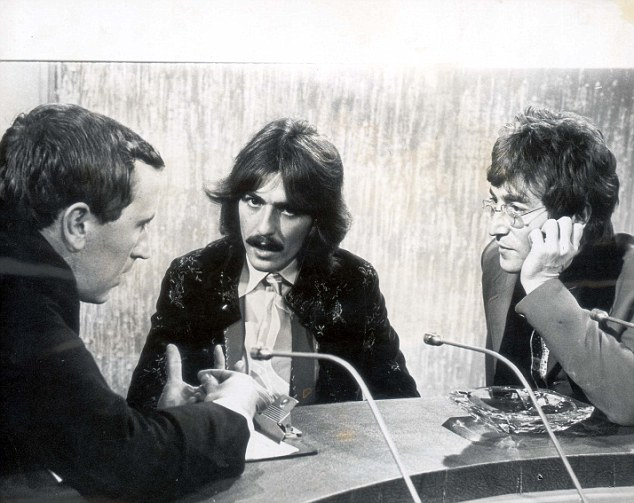 The Beatles' George Harrison and John Lennon answer questions from David Frost on the television programme 'The Frost Report'.  They are discussing to topic of transcendental meditation and LSD