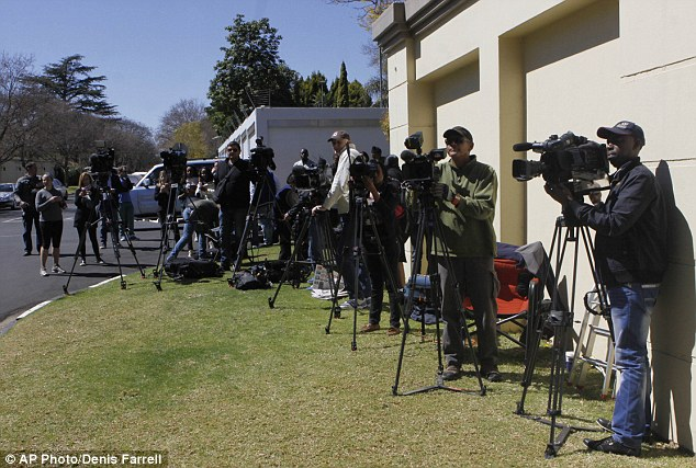 Press gather outside the home of former South African president Nelson Mandela after he was discharged