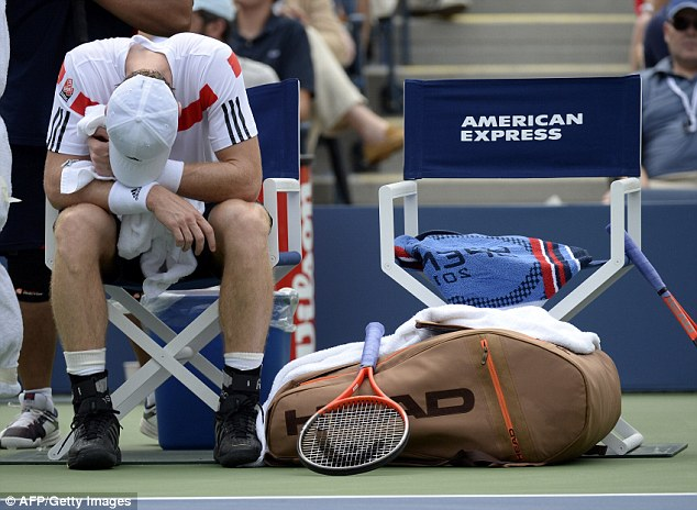 Hard work: Murray takes full advantage of the break in the muggy conditions
