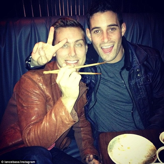 Peace! Lance Bass and his boyfriend have posted numerous happy shots of themselves loving life together