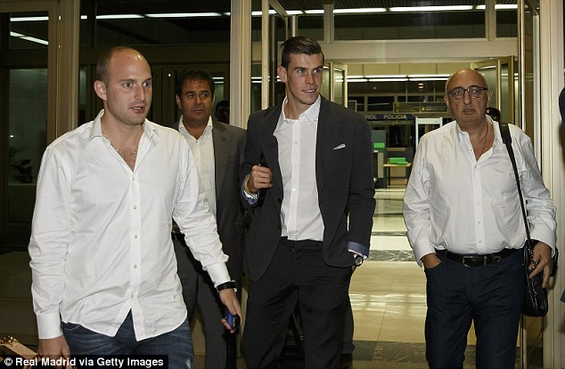 Announced: Gareth Bale arrives at Barajas Airport ahead of his unveiling on Monday