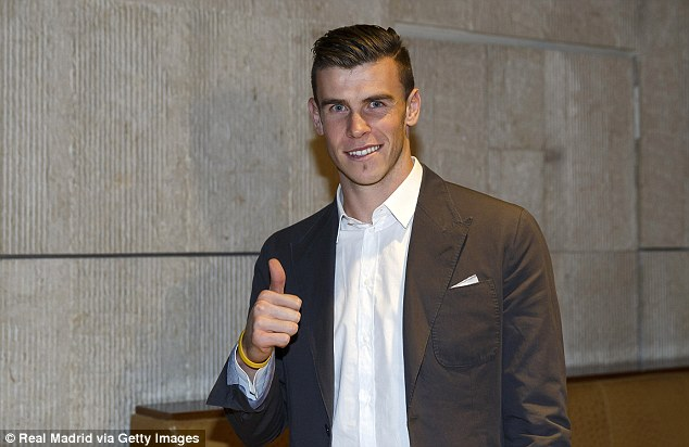 Thumbs up: Bale looked delighted as he arrived in Madrid