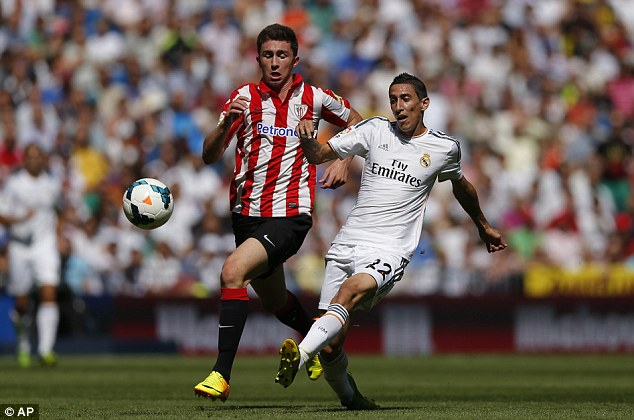 Preferable: Real Madrid boss Carlo Ancelotti has opted to keep Angel Di Maria (above) over Ozil