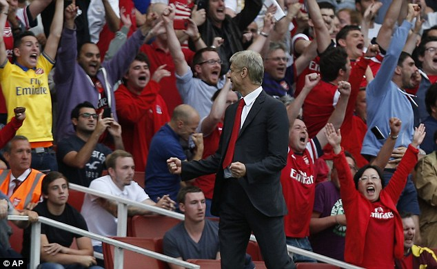 Moving on up: Wenger looks to be making tracks at last at the 11th hour