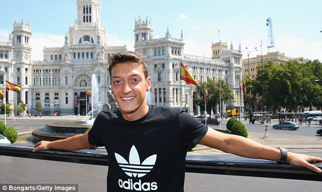 Continental: Ozil is pictured last week in Madrid, but the midfielder will swap one capital for another