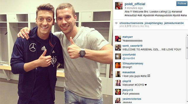 Together: Lukas Podolski poses with his Germany and new Arsenal team-mate