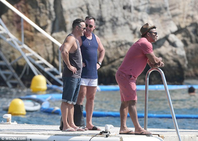 When their boat comes in: David Furnish has lunch at the Hotel Du Cap, Eden Roc Hotel and restaurant in the South Of France with friends