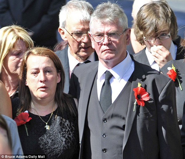Grief: Lyn Rigby, pictured with Lee's stepfather Jack arriving at his funeral, has spoken for the first time about the horrific moment her worst fears were confirmed - that her son was the killed Woolwich soldier