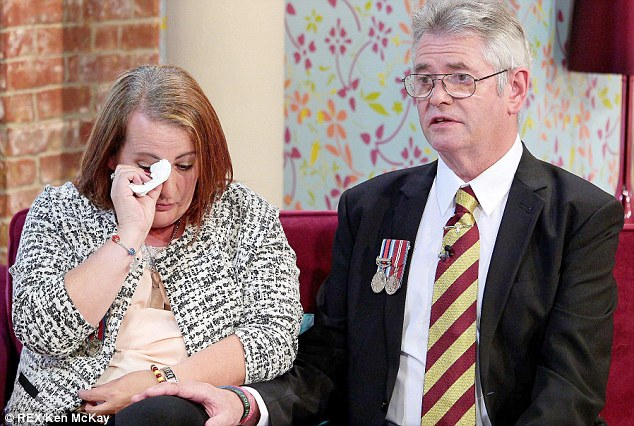 Lee's step-father Ian comforted Lyn as the couple spoke out about their grief for their son; their 'fallen hero'