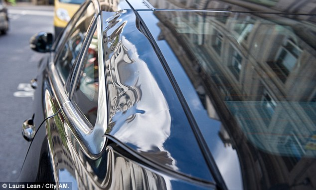 'Burning plastic smell': The car was said to have been in the ray for just an hour but the panels were buckled