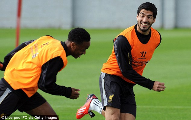 Staying: Luiz Suarez has been all-smiles in training recently, and has now confirmed he is staying at the club