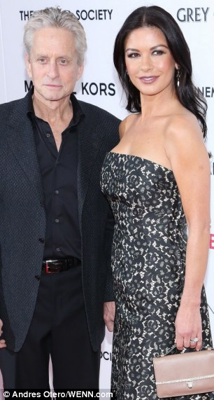 All over: Catherine Zeta Jones and Michael Douglas - and their 25 year age gap - is all over