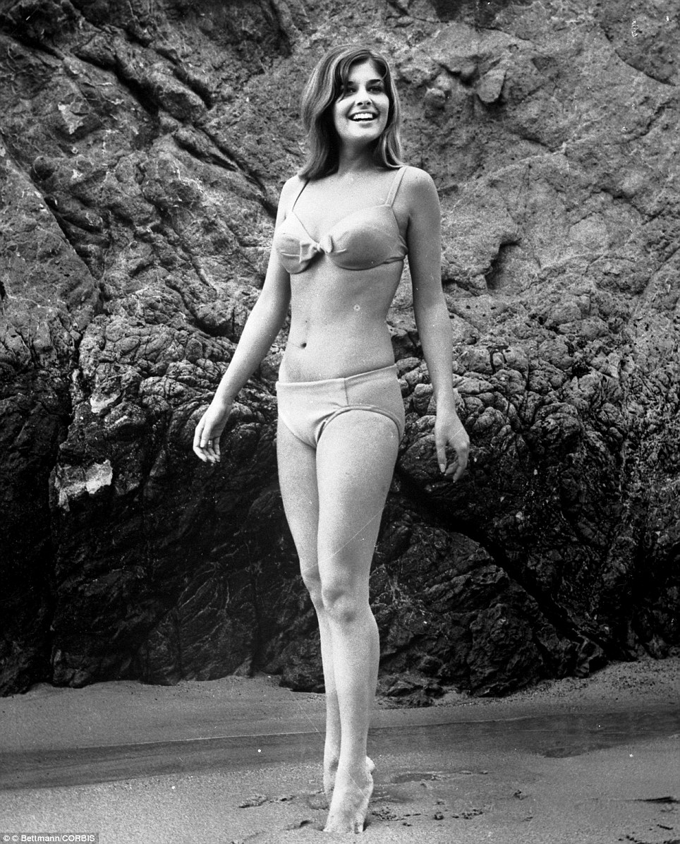 Actress and presenter Christina Ferrare, hits the beach in a bikini in 1967. After a brief speaking part in a Batman TV episode, Ferrare starred alongside David Niven in 1968's The Impossible Years and with Cliff Robertson in J. W. Coop from 1971