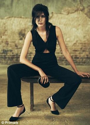 Elegant: This black jumpsuit has a peekaboo detail