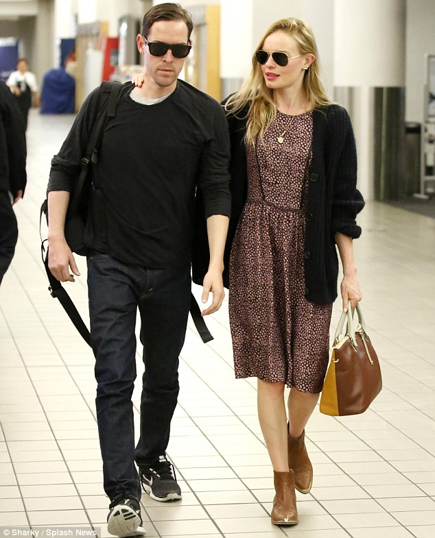Wedded bliss: Kate Bosworth and new husband Michael Polish were seen arriving back in Los Angeles on Monday after their wedding ceremony in Montana on Saturday