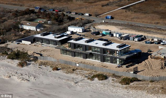 Southern exposure: The 'minimalist' Hamptons beachfront home has elicited gawkin geven from billionaire neighbors and Klein has put up a modest screen in front of his shower that was once exposed to the street