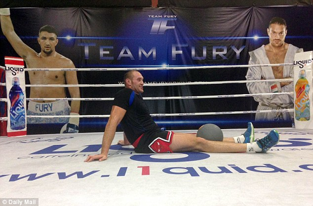 Canvassing opinion: Fury trains with a medicine ball as he readies himself for the biggest fight of his career