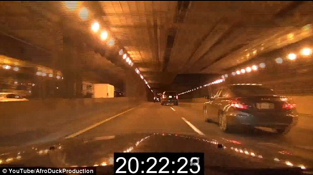 Dare-devil: The motorist weaved through traffic in the city's tunnel but miraculously avoided a collision