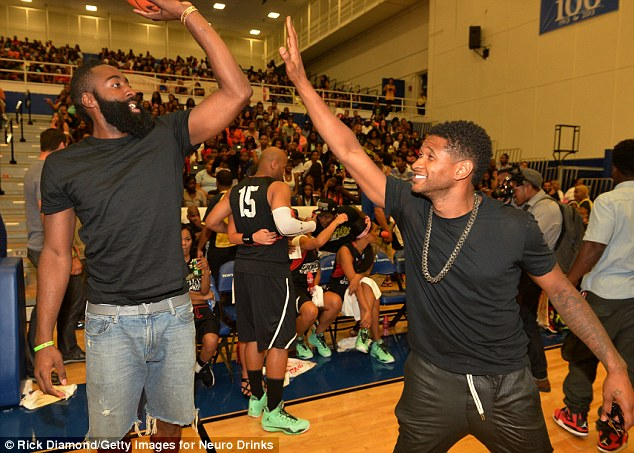 Up high: The eight-time Grammy winner, 34, even faced off with bearded Houston Rockets player James Harden, who was on the gold medal-winning 2012 Summer Olympics team