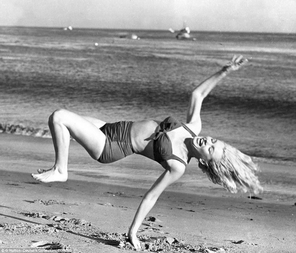 Screen goddess Marilyn Monroe takes a break from filming in the 1950s to frolic on an LA beach