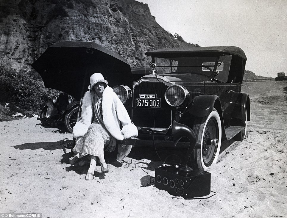 Estelle Taylor, one of the biggest stars of the silent era, listens to the radio at a beach near Hollywood in 1924