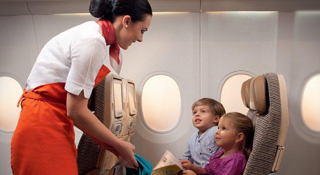 Cabin crew with children on board Etihad plane