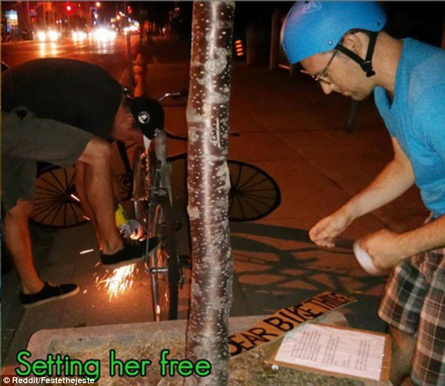 Reclaiming: The friends made a cardboard cut-out bike, cut the stolen bike free and replaced it with their art work