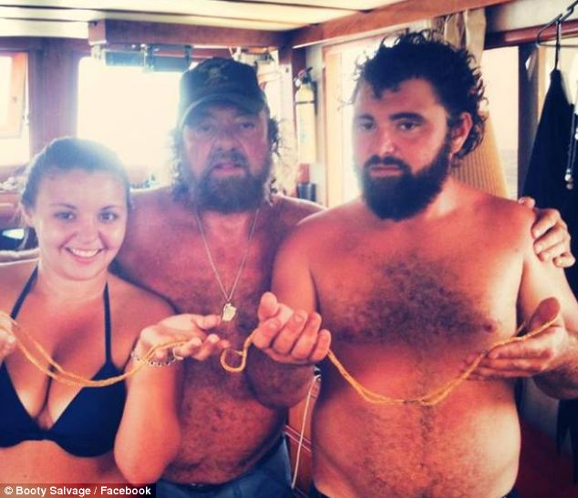 Team effort: Eric Schmitt (right) - along with with his sister Hillary (left), father Rick (center) and other family members runs a diving salvage company named Booty Salvage