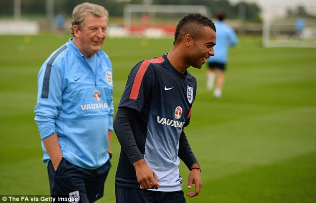 Happier times: Hodgson shares a joke with Ashley Cole at St George's park