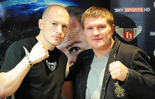 Packing a punch: Hatton Jnr poses alongside older brother Ricky