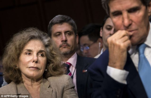 Kerry's wife Teresa Heinz attended the hearing, marking her first public appearance in the months since she was rushed to a hospital near her vacation home on Nantucket on July 7