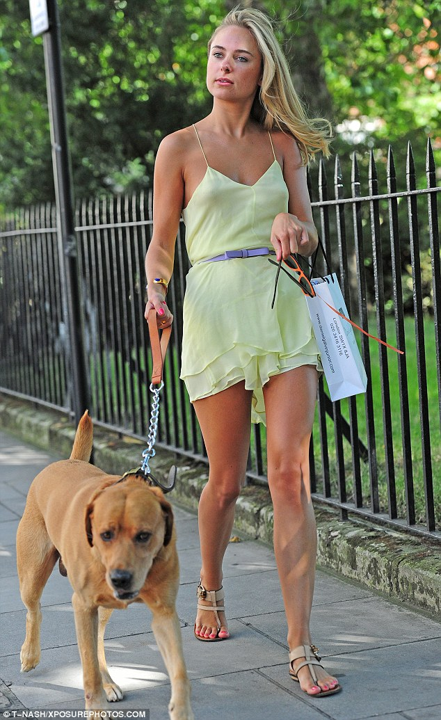 Hot to trot: Made in Chelsea's Kimberley Garner was a summer sensation in a chiffon green dress whilst she was walking her dog