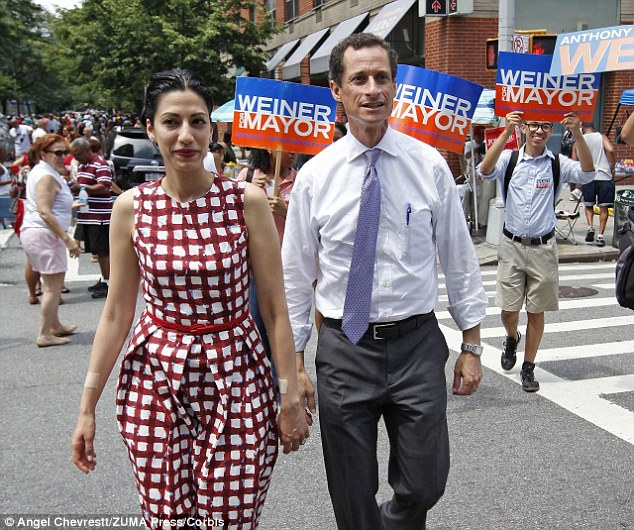 Family man? Sydney Leathers said her former sexting pal Anthony Weiner, seen here with wife Huma Abedin, would 'secretly love' her new size-D breasts