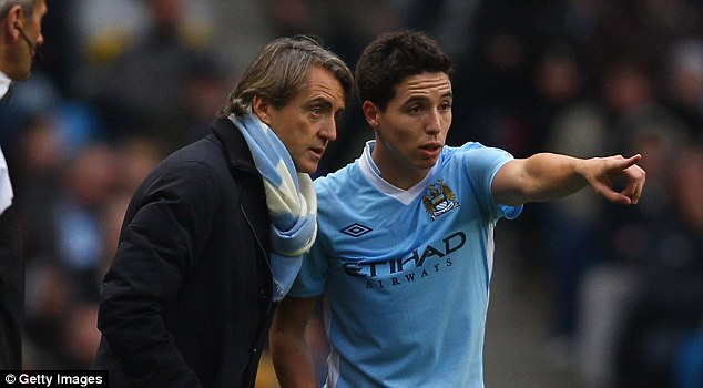 Troubled: Samir Nasri endured a difficult season under Roberto Mancini