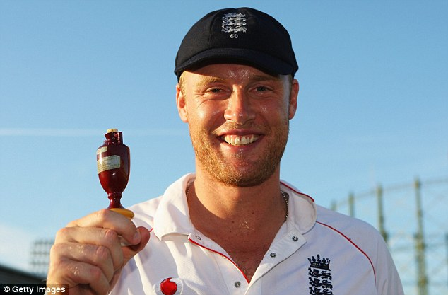 Andrew Flintoff of England poses with the Ashes