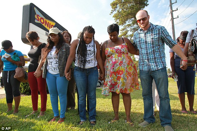United: Parents and family members pray for the victims of the school stabbing